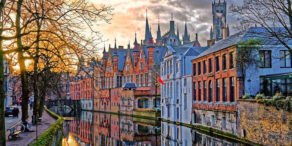 Colorful houses at the shore of a Bruge channel