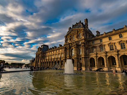 Fountain and Royal Palace of the Louvre Museum in Paris